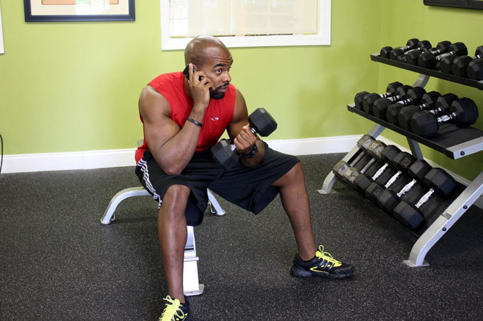 fitness model with phone in gym